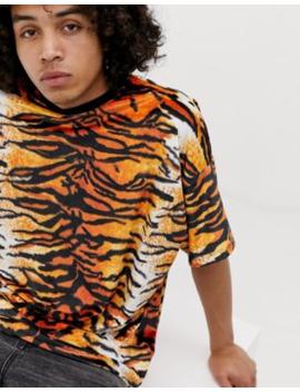 6136d468 Shoptagr   Asos Design Oversized Velour T Shirt In Tiger Print by ...