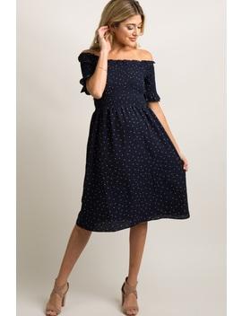 43194b6b3a navy-polka-dot-smocked-maternity-dress by pinkblush