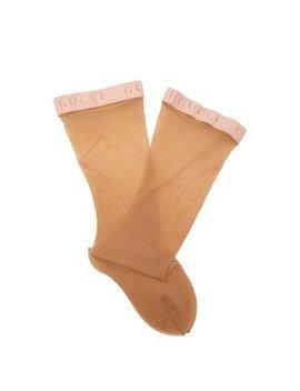 Logo Jacquard Sheer Knee High Socks by Gucci