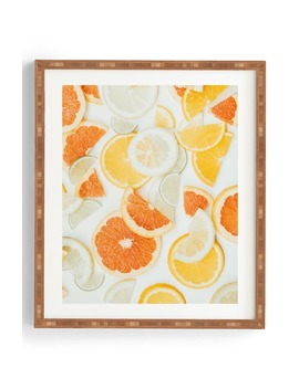 Citrus Orange Twist Framed Wall Art by Deny Designs