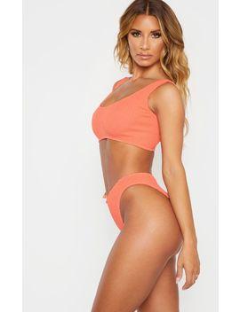 Coral Crinkle Deep Scoop Bikini Top by Prettylittlething